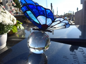 Stained glass butterfly on glass ball