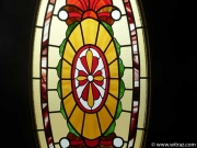 Oval-shaped stained glass in the residence door