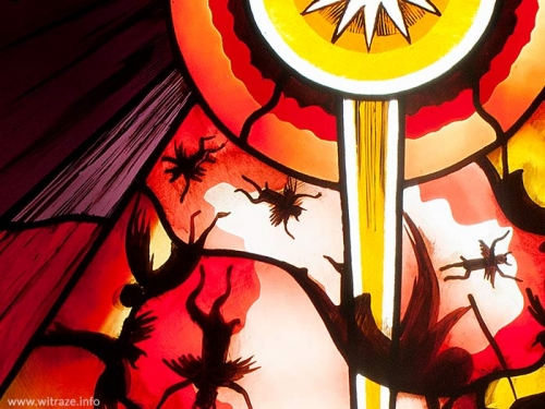 The fight between Good and Evil - stained glass in a restaurant