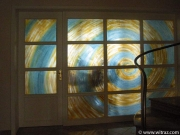 Art glass wall wit the spiral motif