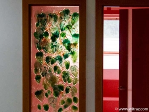 Art glass partitions by the door with the green leafs motif