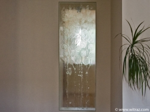 Colourless art glass wall with the floral motif