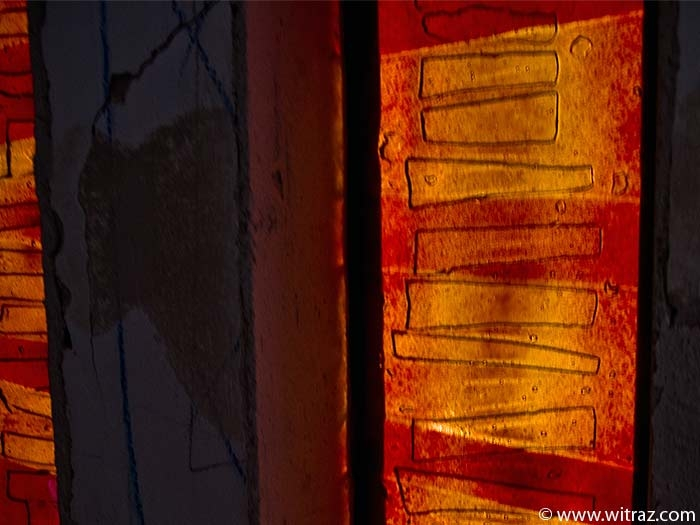 Amber and red coloured art glass