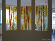 Red and yellow art glass panels in the apartment