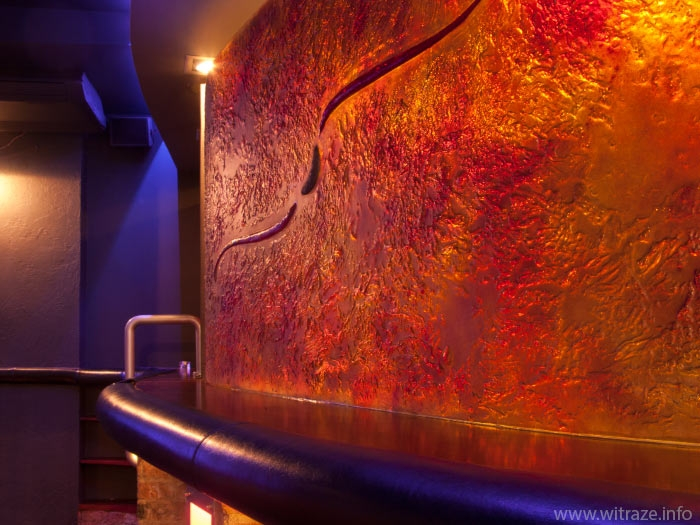 Bent coloured art glas panel in a night club