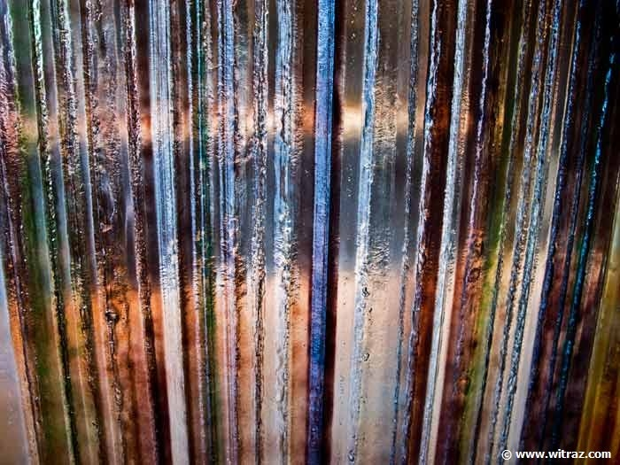 Bent coloured art glass wall