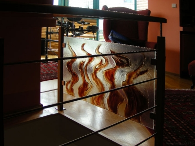 Art glass railing with flames motif