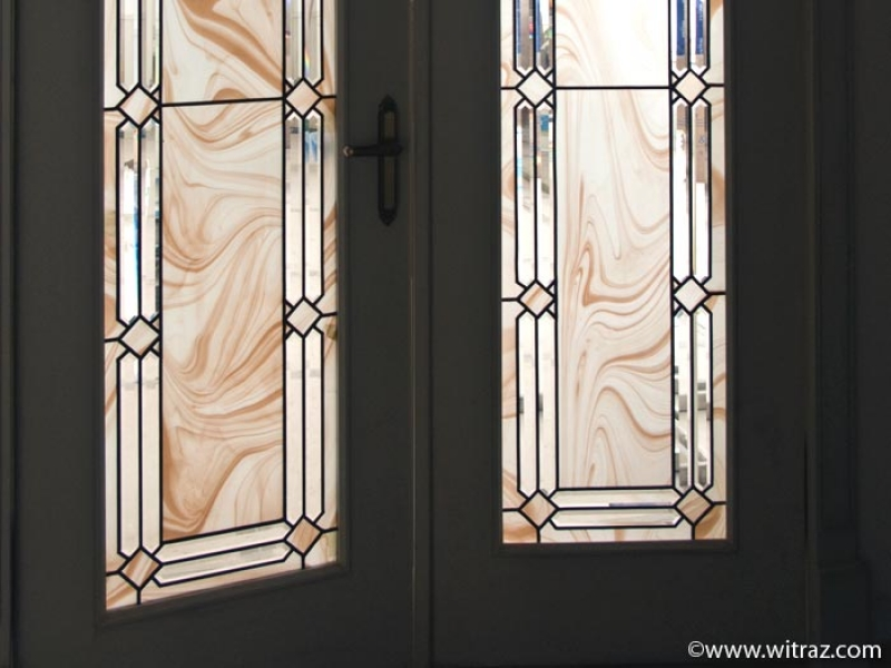 Art Glazings Of Doors With Bevelled Glass Elements