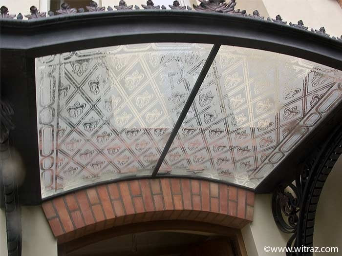 Bent sandblasted art glass canopy