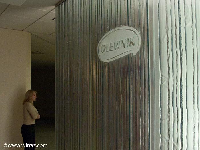 Art glass wall with company logo in Olewnik company seat