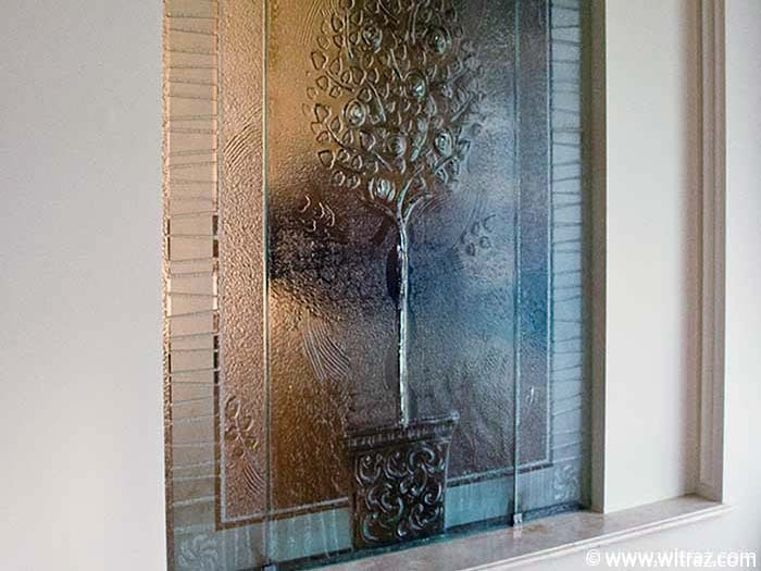 The wall - colourless art glass partition with the orange tree motif