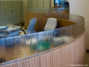 Bent art glass as the office furniture inlay in the bank