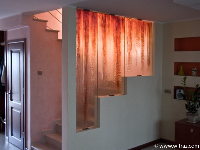Textured gold coloured art glass wall - covers the stairs