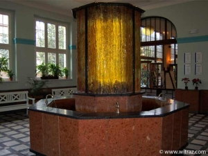 Bent art glass casing of the fountain in the pump-room of Polanica Zdroj resort house