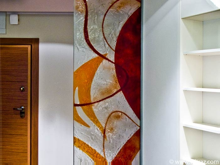 Art glass partition wall in orange and red