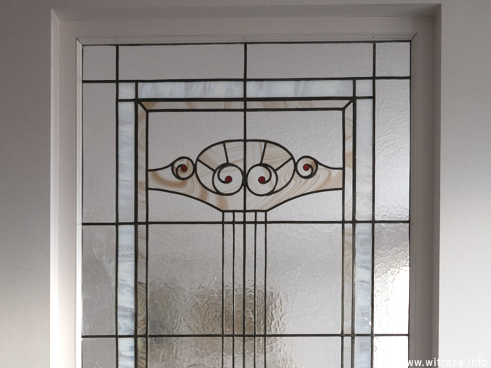 Stained glass panels in art nouveau style.