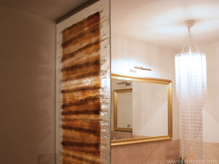 Fused art glass panel as the shower screen in the bathroom