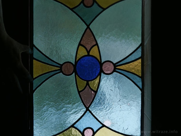 Stained glass with the bullet hole from Warsaw Upraising